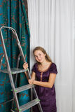 Girl with step-ladder Stock Image