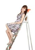Girl on stepladde Stock Photos