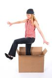 Girl stepping out of the box Royalty Free Stock Photo