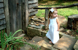 Girl on steps of Cabin royalty free stock photography