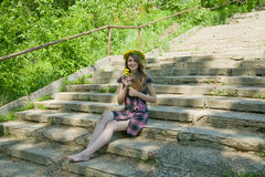 Girl on the steps of stair Royalty Free Stock Images