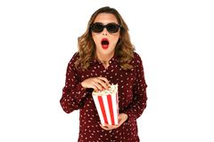 Girl in stereo glasses holding popcorn and posing in surprise. Young girl in stereo glasses holding popcorn and posing in surprise on white background Royalty Free Stock Photo