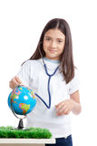 Girl with Stethoscope and Globe Stock Photos