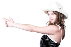 Girl in stetson with gun shooted. Girl in stetson and spotted dress with gun shooted Royalty Free Stock Photos
