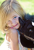 Girl With Stick Pony. Pretty little girl at the park with her stick pony Stock Photography