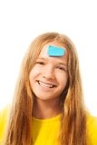 Girl with sticker on forehead Stock Images