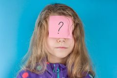 Girl and sticker question mark on forehead stock images