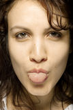 Girl Sticking Her Tongue Royalty Free Stock Images