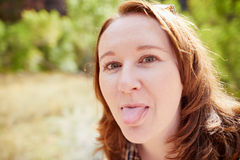 Girl sticking out her tongue Stock Photography