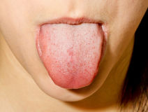 Girl sticking tongue out Stock Photo