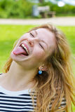 Girl sticking tongue out. Funny girl sticking tongue out Royalty Free Stock Images