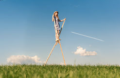 Girl on stilts Royalty Free Stock Images