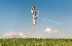 Girl on stilts. Nature fairytale: girl, walking on stilts royalty free stock images
