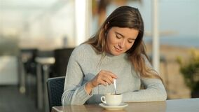 Free Girl Stirring Coffee Sitting In A Restaurant In Slow Motion Stock Photography - 172371782