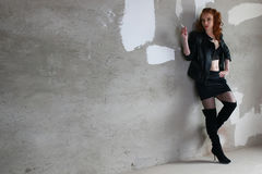 Girl stockings boots leather jackets Royalty Free Stock Photo
