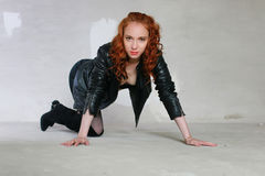 hooker boots. Girl Stockings Boots Leather Jackets. Portrait Of A Young Red-haired On Hooker