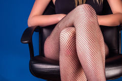 Girl in stockings sitting Royalty Free Stock Image