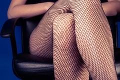 Girl in stockings sitting Royalty Free Stock Images