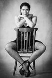 Girl in stockings sitting astride a chair. The picture was taken in a personal studio photographer. Girl in stockings sitting astride a chair Royalty Free Stock Photo