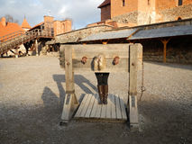 Girl in the stocks. Girl is in block, located in the central square of the castle Trakai Lithuania Stock Photography