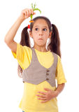 Girl with stomach pain and carrot Royalty Free Stock Photos