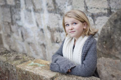 Girl on stone balcony in an old fortress Royalty Free Stock Image