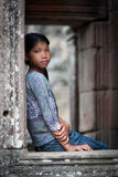 Girl in stone doorway Angkor Wat Temple Stock Photo