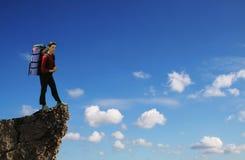 Girl on the stone peak Stock Image