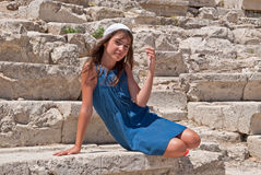 Girl on the stone. Royalty Free Stock Images