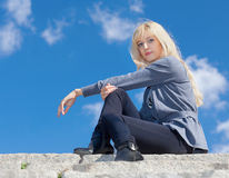 Girl on the stone steps Stock Photography