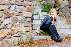 Girl on the stone steps Royalty Free Stock Photos