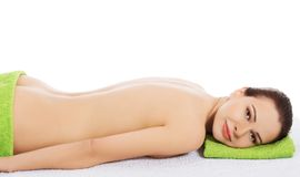 Girl on a stone therapy, hot stone massage Royalty Free Stock Photos