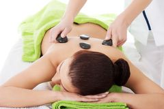 Girl on a stone therapy, hot stone massage Stock Images