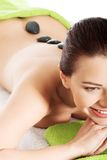 Girl on a stone therapy, hot stone massage Stock Image