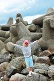 Girl  on stones Stock Image