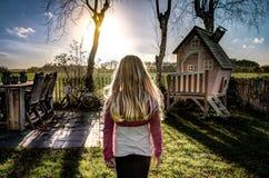 Girl stood in garden sunshine