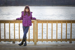Girl stood by lake Stock Photography