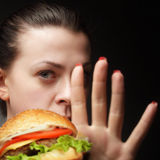 Girl stop junk food Stock Photo