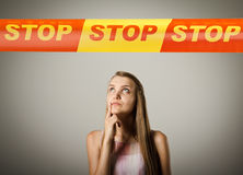 Girl and STOP line. Stock Photos
