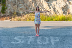 Girl and Stop Sign Royalty Free Stock Photo