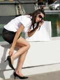 Girl stopped to fix a shoe Royalty Free Stock Images