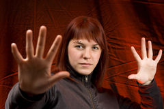 Girl stopping someone. Girl with her hands stretched forward Stock Photography
