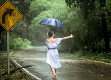 Girl stops the car in the rain stock photography