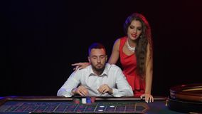 Girl stops the man from the wrong rate. Roulette casino stock video footage