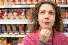 Girl in store looks upward royalty free stock image