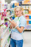 Girl at the store purchasing cosmetics Royalty Free Stock Images