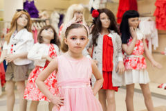 The girl in the store trying on a pink dress Royalty Free Stock Photos