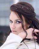 Girl straightens her hair Royalty Free Stock Photos