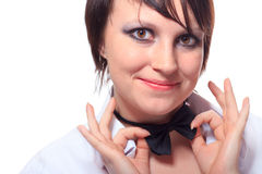 Girl straightens tie a bow tie Royalty Free Stock Photo