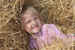 Girl in straw Royalty Free Stock Photography